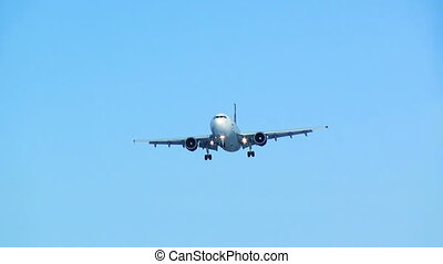 Plane landing with undercarriage out. Blue sky background. HD 1080.