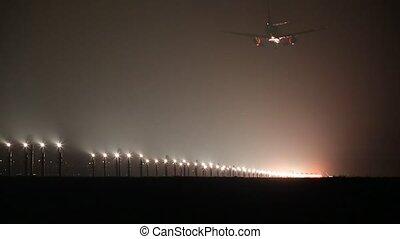 Plane landing in fog at night