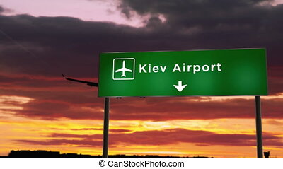 Airplane silhouette landing in Kiev, Ukraine. City arrival with airport direction signboard and sunset in background. Trip and transportation concept 3d animation.