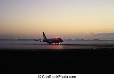Plane landing in mist