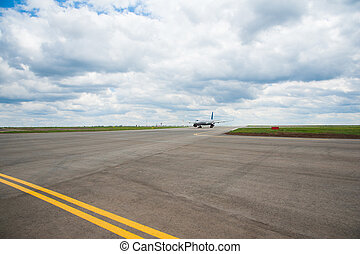 Plane lands in the airport runway