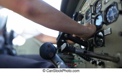 Plane lever and pilot navigating - A medium shot of a...