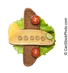Plane made of bread and cheese on white background
