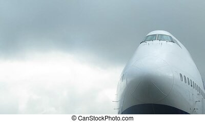 Plane nose is visible against sky close up