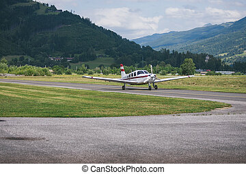 Plane on a background of mountains