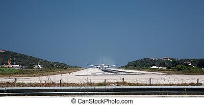 Plane on the runway at Skiathos airport