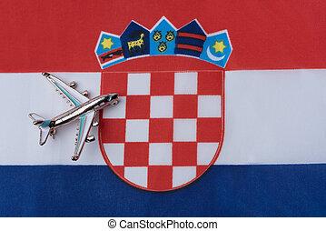 Plane over the flag of Croatia travel concept.
