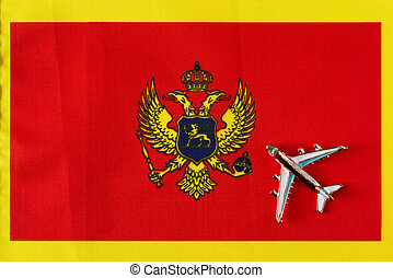 Plane over the flag of Montenegro travel concept.