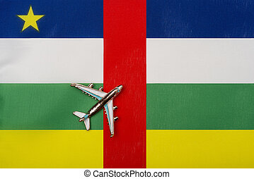Plane over the flag of the Central African Republic travel concept.