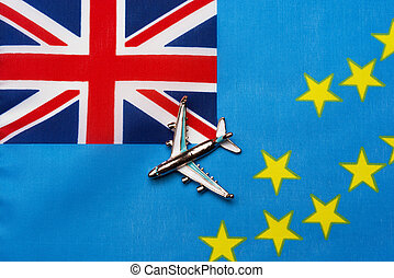 Plane over the flag of Tuvalu the concept of travel and tourism.