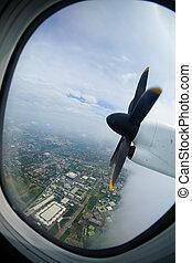 Plane propeller seen through the window