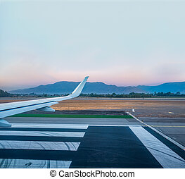Jet wing prepared for takeoff on runway