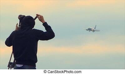 Plane Spotter Shooting Landing Airplane