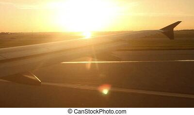 Plane Takeoff at Sunset