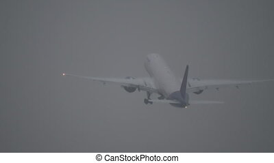 Plane taking off during a storm - Long shot of a jet plane...