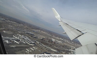 Plane taking off from airport, View through an airplane...