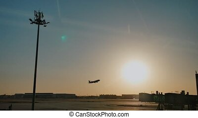Plane taking off sky sunset sun dusk in airport China. Beijing.