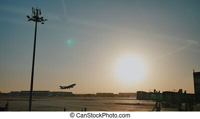 Plane taking off sky sunset sun dusk in airport China....