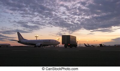 Plane TATARSTAN stands on take-off field on sunset on...