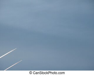 Plane trace. The blue sky.