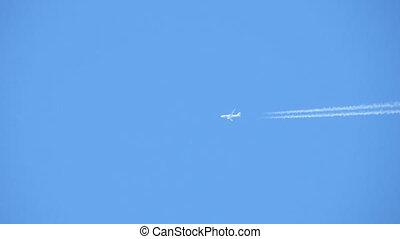 Plane - Bottom view of flying plane over blue sky