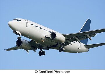 White commercial airplane against clear blue sky