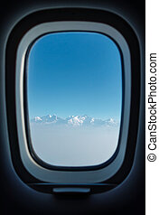 Plane window with a view on the Himalayas