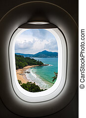 Plane window with island view