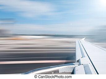Plane wing at take off or landing.