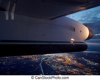 Plane Wing flies over City of Seattle at night