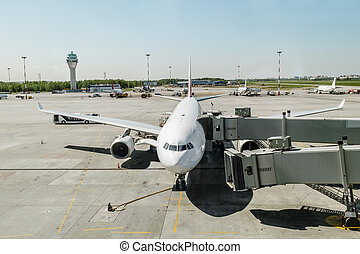 Plane with boarding ramp at the airport Pulkovo. Russia.