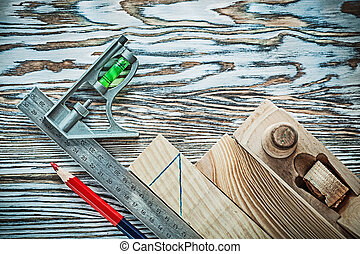 Planer building board pencil level try square.