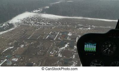 Plane's dashboard. Winter landscape outside window