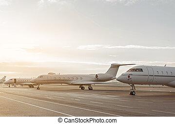 Planes situating at landing strip before flight - Passenger...