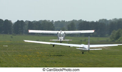 Planes taking off video in summer day - Light engine planes...