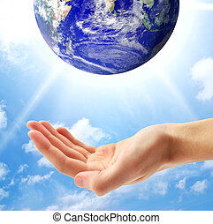 Planet Earth and human hand