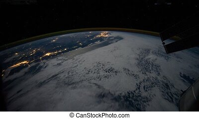 Planet Earth from flying satellite at night