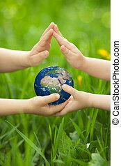 Planet Earth in children`s hands