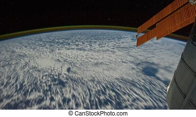 Planet Earth is cover by clouds visible from shuttle window