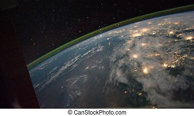 Planet Earth is visible of space at night