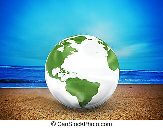 Planet earth model on the beach