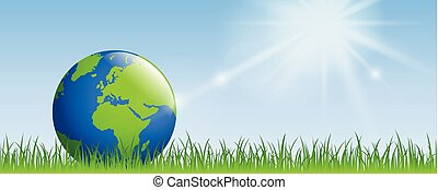 planet earth on green meadow with sunshine banner with copy space