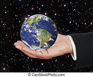 Planet earth on palm. Elements of this image furnished by NASA