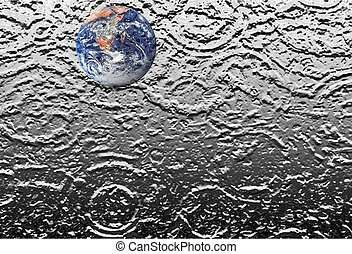 Planet Earth on water puddle