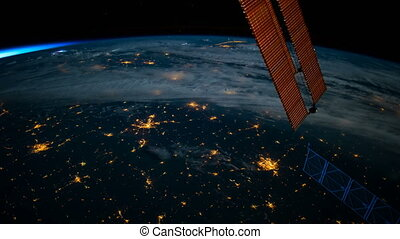 Planet Earth seen from the ISS. Space exploration of planet Earth at night. Elements of this video furnished by NASA.