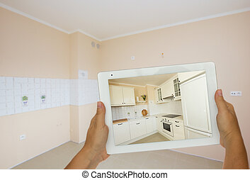 planing new kitchen on tablet - planing new kitchen...