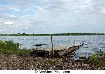 Planked footway at riverbank - Wooden berth at Onega ...