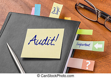 Planner with sticky note - Audit