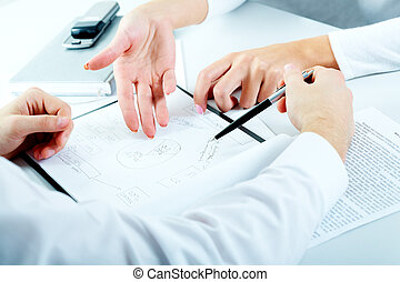 Planning - Close-up of business people planning a new...