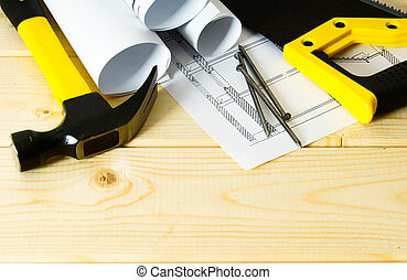 Drawings for building and working tools on wooden background.